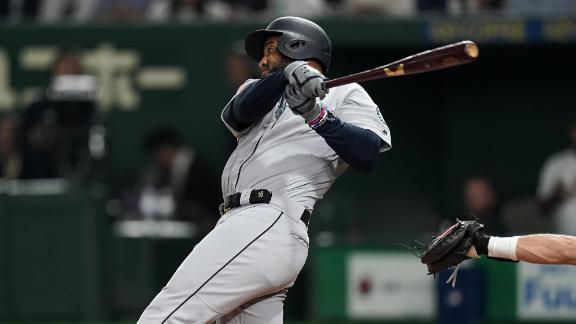 Santana's grand slam leads Mariners to win vs. A's in Japan