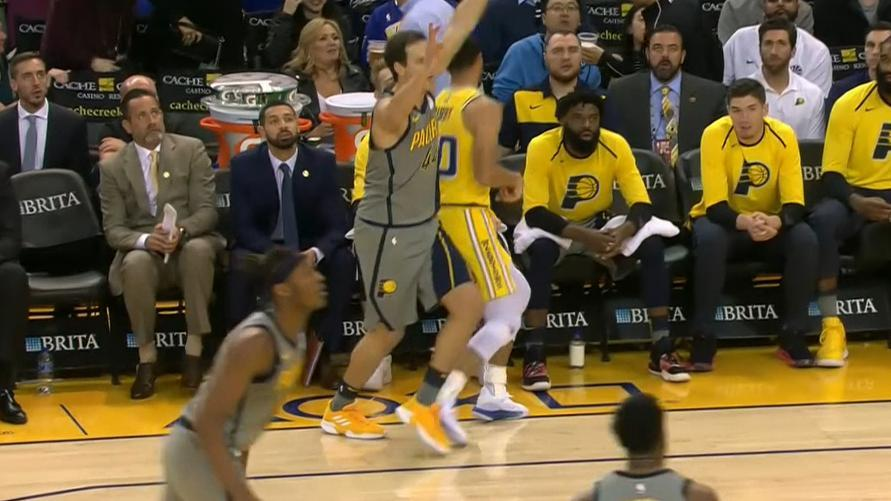 Curry turns around before his 3 goes in