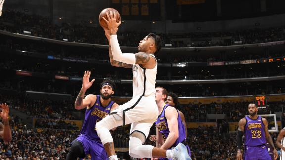 Russell's double-double helps end Lakers' playoff hopes