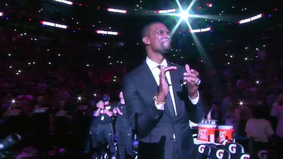 Bosh honored by Heat retiring his jersey