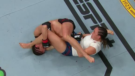 Kowalkiewicz survives armbar attempt from Waterson