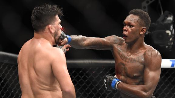 Adesanya outslugs Gastelum to win interim middleweight belt