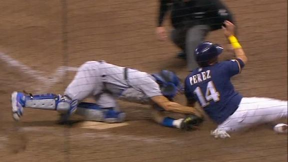 Verdugo fires home to get out Perez at the plate