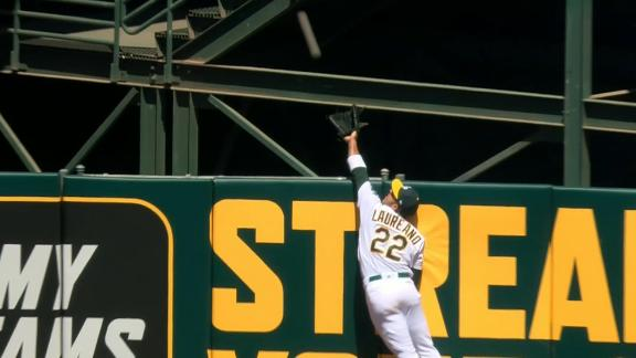 Laureano robs HR, overthrow to first leads to second out