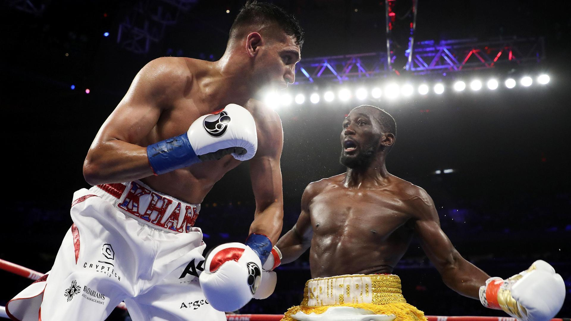 Crawford drops Khan in first round