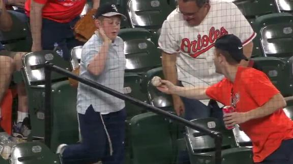 Young Sox fan reluctantly accepts baseball from O's Fan