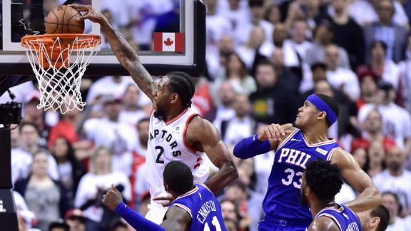 Kawhi splits defenders midair for one-handed dunk