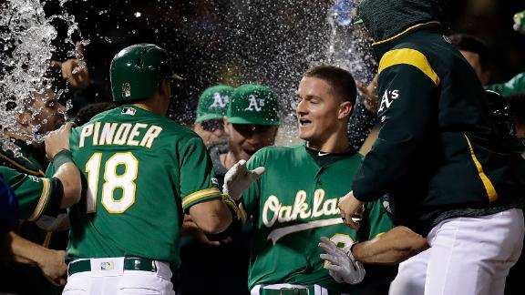 Chapman's walk-off HR lifts A's to win in 12th