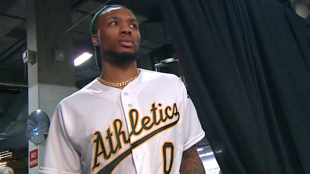 Lillard arrives in customized A's jersey