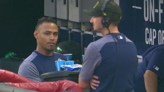 Arcia playing waiter in Brewers' dugout