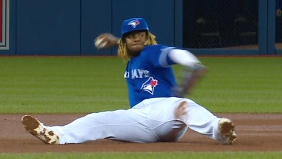 Vlad Jr. makes nice throw from the ground