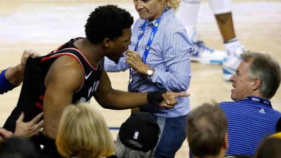 Lowry gets push by fan after dive into stands