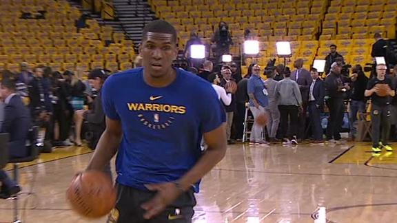 Looney warms up after being declared active for Game 4