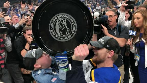 Laila Anderson kisses the Stanley Cup