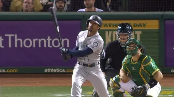 Mariners belts two late homers to sink A's
