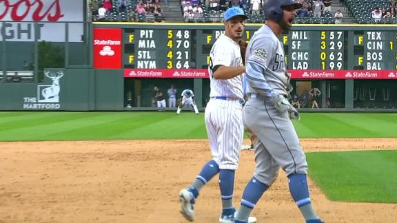 Padres score 4 in the 9th, shock the Rockies