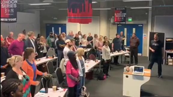 London volunteers learn how to sing 'Take Me Out to the Ballgame'