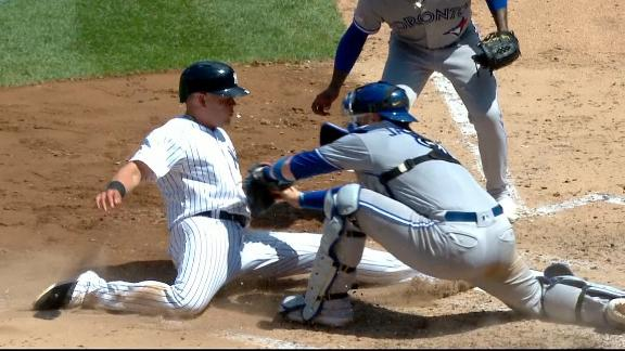 Yanks go up as Urshela slides under tag