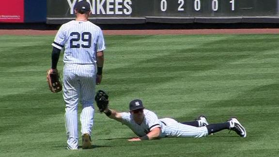 Tauchman robs Biggio with diving catch