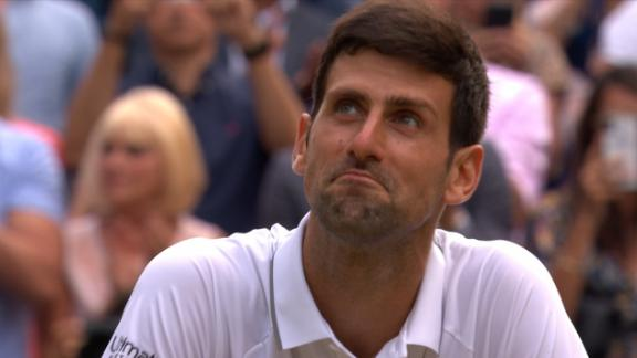 Djokovic celebrates with a taste of Centre Court grass