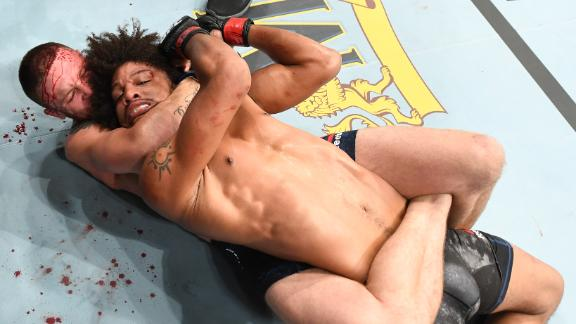 Peterson locks Caceres in body triangle