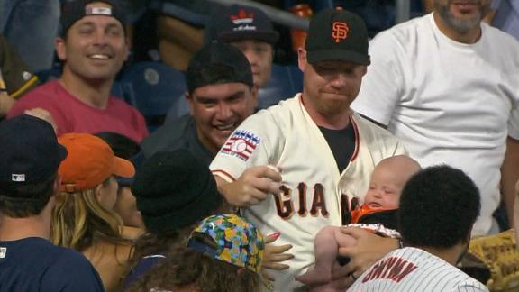 Giants fan snags Sandoval homer while cradling baby