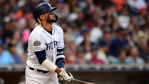 Tatis hits homer after inside pitch sends him to the dirt