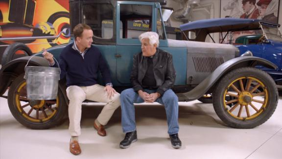 Peyton examines the vintage automobile that helped found the NFL