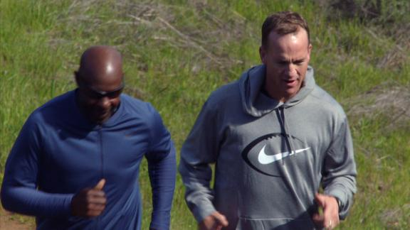 Manning runs Rice's hill with the legendary WR