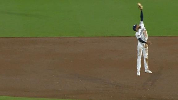 Tatis gets all the way up to make the catch
