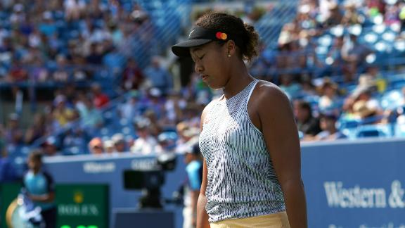 Osaka injures knee, retires from match