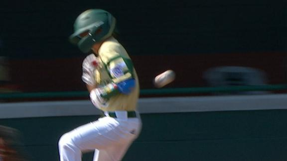 South Korea scores 2 after baserunner gets hit with throw