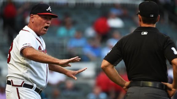 Braves manager gets tossed after first pitch pegs Acuna