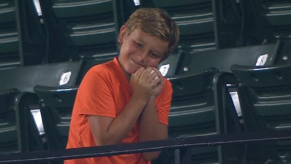Kid in upper deck hugs and kisses foul ball