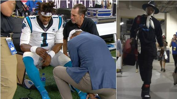 Cam suffers foot injury, leaves stadium in a boot