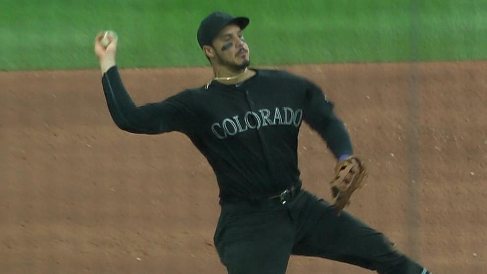 Arenado makes spectacular play at third