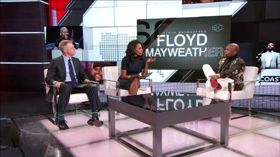 Cari Champion confronts Floyd Mayweather about domestic violence