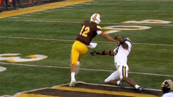 Wyoming QB stiff-arms his way to 75-yard TD