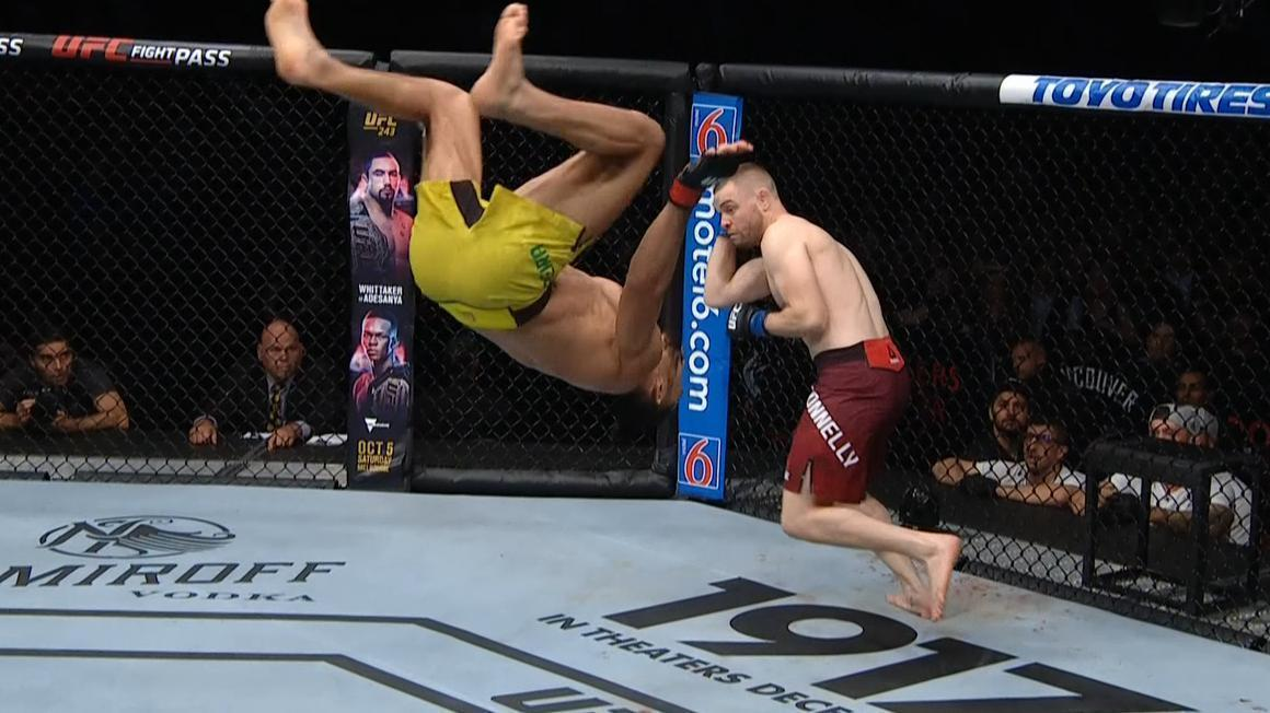 Pereira does a backflip in fight