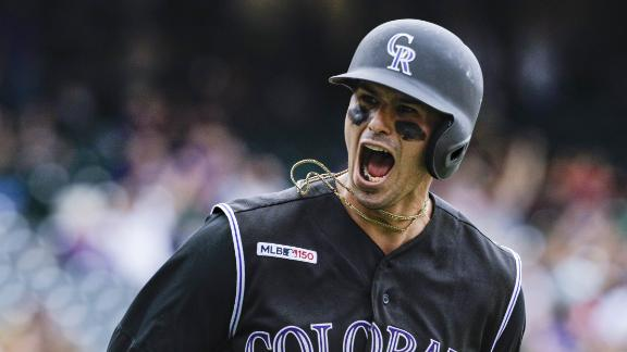 Rockies' bats catch fire in win vs. Padres