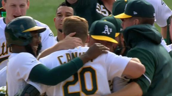 Canha whacks walk-off double in 11th