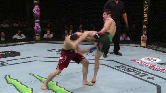 Moreno catches Askarov with head kick