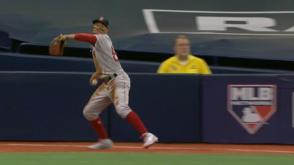 Betts shows off the arm to get runner at third