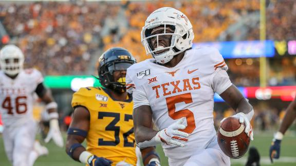 Kendall throws four INTs as WVU falls to Texas
