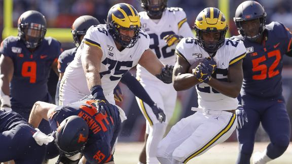 Michigan holds off Illinois' rally for fifth win