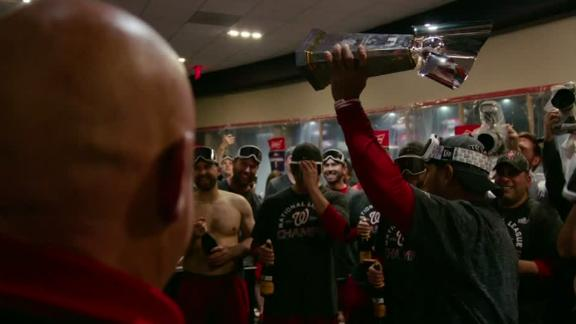 Martinez speaks to team, gets showered with champagne