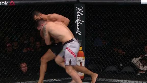 Reyes fights off Weidman's takedown attempt
