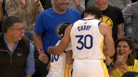 Steph celebrates with young fan after buzzer-beating 3