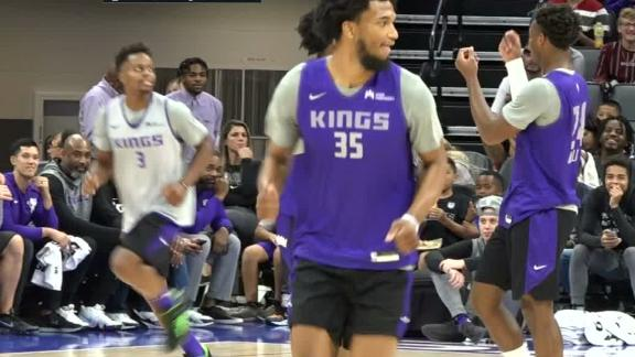 Buddy Hield shows the money hands to Vlade Divac