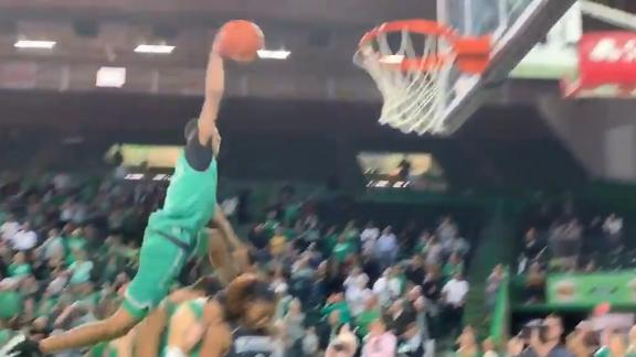 Marshall University student leaps over five guys to dunk